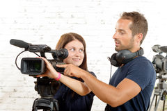 Young cameraman and a  young woman Royalty Free Stock Photography