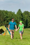 Young camping couple hold hands summer countryside. Young camping couple hold hands in summer countryside tent royalty free stock image