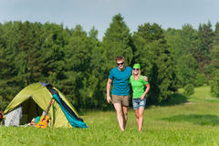 Young camping couple hugging in summer countryside Stock Image