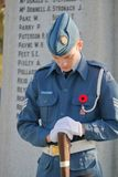 Young Canadian Soldier and Memorial stock image