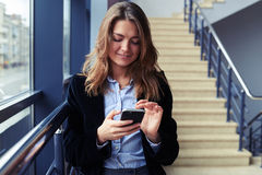 Young candid female using cellphone Royalty Free Stock Image