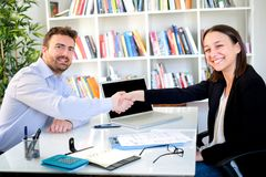 Young candidate handshake during successful job interview. Young candidate looking for a job and successful job interview stock images