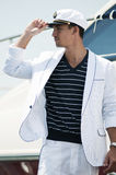 Young captain looking away. Handsome young captain in white dress looking away Royalty Free Stock Photography
