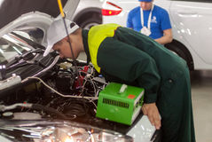 Young car mechanic passes competition stage.Tyumen Stock Images