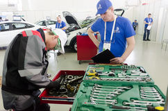 Young car mechanic passes competition stage.Tyumen royalty free stock images