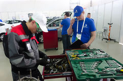 Young car mechanic passes competition stage.Tyumen Stock Photo