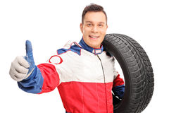 Young car racer giving a thumb up Royalty Free Stock Photos