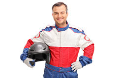 Young car racer holding a gray helmet Stock Images