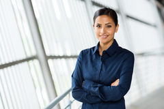 Young career woman. Beautiful young career woman in modern office Royalty Free Stock Photography