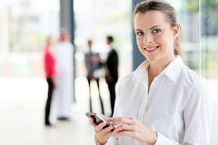 Young career woman. Beautiful young career woman using cell phone Stock Image