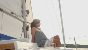 Young carefree girl sitting on yacht, happiness, emotions, joy. Stock footage stock video