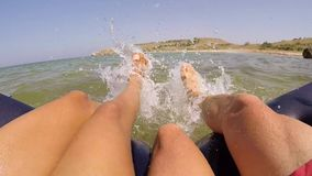 Young carefree teenagers couple talks feet in the water splashing. HD, 1920x1080. stock video footage