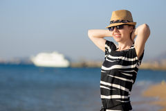 Young carefree woman at sea shore royalty free stock photo