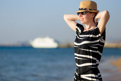 Young carefree woman at seashore Stock Photo
