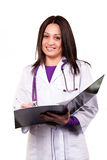 Young caring doctor. Or health care worker in white uniform, with stethoscope and black folder Stock Image