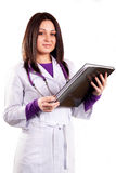 Young caring doctor in white uniform. With stethoscope and black folder Royalty Free Stock Photos