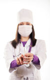 Young caring doctor in white uniform. A cute young doctoror health care worker in white uniform, protective mask,  holding injection on white background Royalty Free Stock Photos