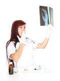 Young caring doctor with x-ray Stock Photography
