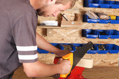 Young carpenter cutting Royalty Free Stock Photos