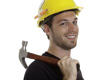 Young carpenter in front of a white background Royalty Free Stock Photo