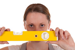 Young carpenter holding a spirit level Royalty Free Stock Photo