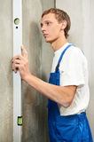 Young carpenter man worker with level Royalty Free Stock Photos