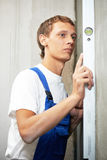 Young carpenter man worker with level Royalty Free Stock Images