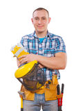 Young carpenter with tools standing and looking at camera Stock Photos