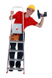 Young carpenter up ladder Stock Image