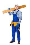 Young carpenter whis wooden plank stock photos