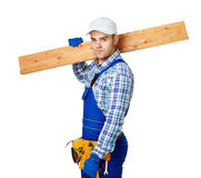 Young carpenter whis wooden plank Royalty Free Stock Image