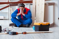 The young carpenter at work tired feeling not well. Young carpenter at work tired feeling not well Stock Photo