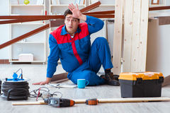 The young carpenter at work tired feeling not well. Young carpenter at work tired feeling not well Royalty Free Stock Photo