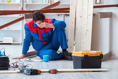 The young carpenter at work tired feeling not well. Young carpenter at work tired feeling not well Royalty Free Stock Photography