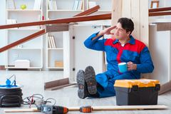 The young carpenter at work tired feeling not well. Young carpenter at work tired feeling not well Royalty Free Stock Image