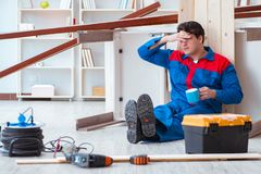 The young carpenter at work tired feeling not well. Young carpenter at work tired feeling not well Stock Photos