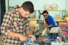Young carpenter at work stock photos