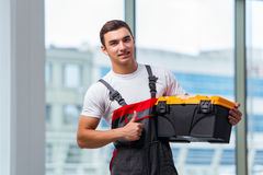 The young carpenter working at construction site Royalty Free Stock Image