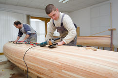 Young carpenters assembling new canoe Royalty Free Stock Photo
