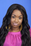 Young Carribean woman. Studio portrait on blue backround Royalty Free Stock Images