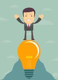 Young cartoon businessman on light bulb Royalty Free Stock Images