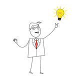 Young cartoon businessman pointing at light bulb Stock Photography