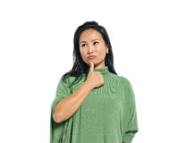 A Young Casual Asian Woman Thinking.  Royalty Free Stock Photo