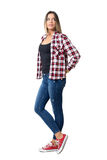 Young casual beautiful girl with hands in back pockets looking behind over the shoulder. Royalty Free Stock Photo