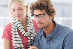 Young casual business couple Stock Photos