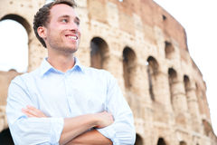 Young casual business man, Colosseum, Rome, Italy. Young casual business man portrait by Colosseum, Rome, Italy. Proud confident happy smiling cross-armed Stock Photo