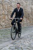 Young casual business man riding his bike Stock Photos