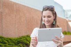Young casual business woman using tablet on a break Stock Images