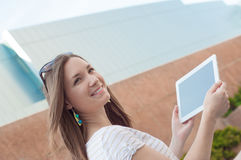 Young casual business woman using tablet on a break Stock Photos