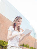 Young casual business woman using tablet on a break Stock Photography